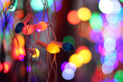 Colorful line of festive decoration lights, on the background of Stock Photos