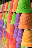 Colorful line of flower pots Royalty Free Stock Photos
