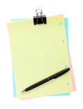 Colorful lined office paper with clip and pen Stock Photos