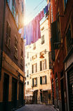 Colorful linen drying between houses in old italian street Stock Photos