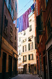 Colorful linen drying between houses in old italian street Royalty Free Stock Images