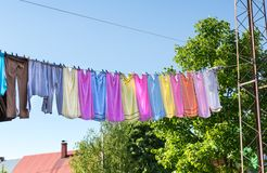 Colorful linen drying in summer Stock Photos