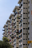 Colorful linen to dry the windows of high-rise building in the city Stock Images
