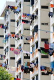 Colorful linen to dry the windows of high-rise building in the city Stock Photography