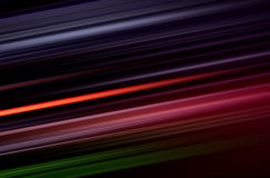 Colorful lines blurred pattern on black Royalty Free Stock Image