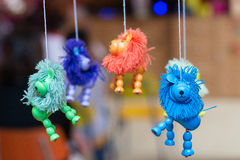 Colorful lion toys. With shaggy manes hanging from string Royalty Free Stock Photo