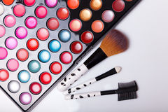 Colorful lip gloss palette with set of brushes Stock Image