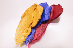 Colorful lipstick mass closeup on white backdrop Stock Photography