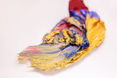 Colorful lipstick mass smeared closeup on backdrop Stock Images