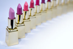Colorful lipstick samples. A lineup of a variety of colored lipstick applicator samplers Royalty Free Stock Photography
