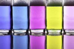 Colorful liquid chemical cleaning agents in glass bottles Stock Photography
