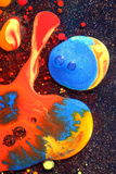 Colorful Liquid Paints. Bstract colorful liquid paints on a metallic surface enclosed with oil royalty free stock photos