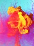 Colorful liquid paints stock photography