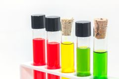 Colorful liquid in test tubes on rack. Close up of colorful liquid in test tubes on rack Stock Image