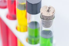Colorful liquid in test tubes on rack. Close up of colorful liquid in test tubes on rack Stock Photo