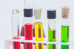 Colorful liquid in test tubes on rack. Close up of colorful liquid in test tubes on rack Stock Images