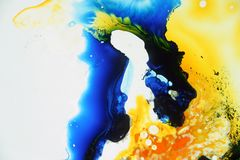 Colorful liquids mixed together to an abstract painting. Colored liquids mixed together in fluid creating colorful abstract painting consisting of gradients and stock photos