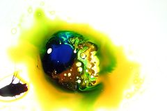 Colorful liquids mixed together to an abstract painting. Colored liquids mixed together in fluid creating colorful abstract painting consisting of gradients and stock photography
