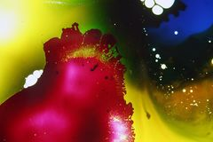 Colorful liquids mixed together to an abstract painting. Colored liquids mixed together in fluid creating colorful abstract painting consisting of gradients and royalty free stock image