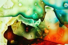 Colorful liquids mixed together to an abstract painting Royalty Free Stock Images