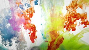 Colorful liquids mixing under water. Colorful paint in dynamic flow. Color jet of ink on green background. Liquid organic sculptures under water.  Slow motion stock footage