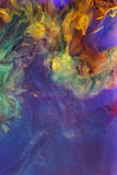 Colorful liquids underwater. Colorful abstract composition. Colorful abstract composition. Interesting shapes, patterns, rich textures, color mixing. Space for stock photos