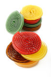 Colorful liquorice licorice spiral candies on white Royalty Free Stock Images