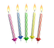 Colorful lit candles Stock Photos