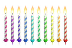 Colorful lit candles isolated over white Royalty Free Stock Photo