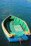 Colorful little boat in a harbor Stock Photo