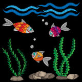 Colorful little fish under water embroidery stitches imitation. On the black background. Embroidery fish with wave for logo, label, emblem, sign, poster, t Stock Photography