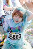 Colorful little girl covered in chalk Stock Images