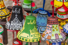 Colorful little painted souvenir bells of Lviv Stock Photo