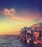 Colorful Little Venice of Mykonos island at sunset with cloud in form of heart Royalty Free Stock Photography