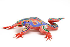 Colorful lizard #2. Colorful hand carved lizard. This type of carving is called Alebrije which means mythical animal and are done by street vendors in Oaxaca Stock Photography