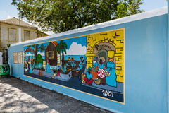 Colorful local Caribbean expressionism on a wall. In downtown Frederikstedsted Stock Photography