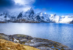 Colorful Lofoten Islands Scenery with Group of Houses Against Snowy Mountains Royalty Free Stock Photography