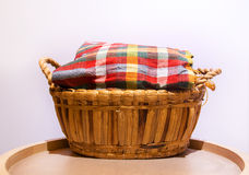Colorful loincloth fabric on rattan basket Royalty Free Stock Photos