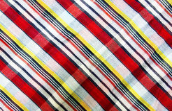 Colorful loincloth fabric in thailand background Stock Photo
