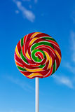 Colorful lollipop with blue sky background Stock Images