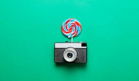 Colorful lollipop and camera Royalty Free Stock Images