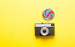Colorful lollipop and camera Royalty Free Stock Image