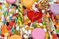 Colorful lollipop and candy. On a white background stock photography