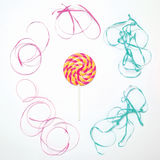 Colorful lollipop caramel on stick with ribbon on a white background Royalty Free Stock Images