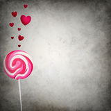 Colorful lollipop with floating hearts Stock Photos