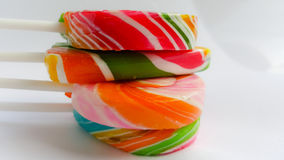 Colorful lollipop sticks on white paper background Royalty Free Stock Image
