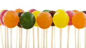 Colorful lollipops. In a row on a white background Stock Photography
