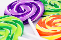 Colorful lollipops. Colorful swirled lollipops on a white background Stock Images
