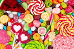 Colorful Lollipops And Different Colored Round Candy. Stock Photo