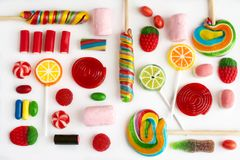 Colorful lollipops and candies Stock Photos